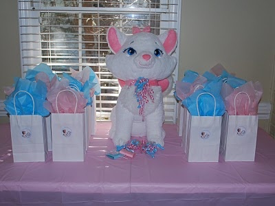 Aristocats birthday theme!  Paisley would freak! Love the idea of displaying her Marie stuffed cat at the party.