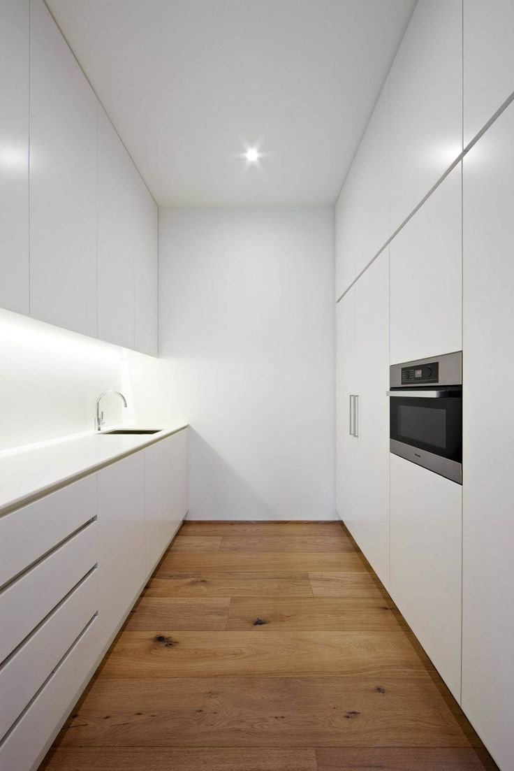 Modern white kitchen by Urban Angles