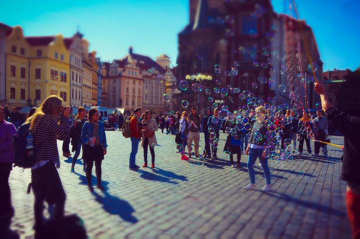 Chasing Bubbles In Old Town Square Prague by Leopard Print Photography Prague