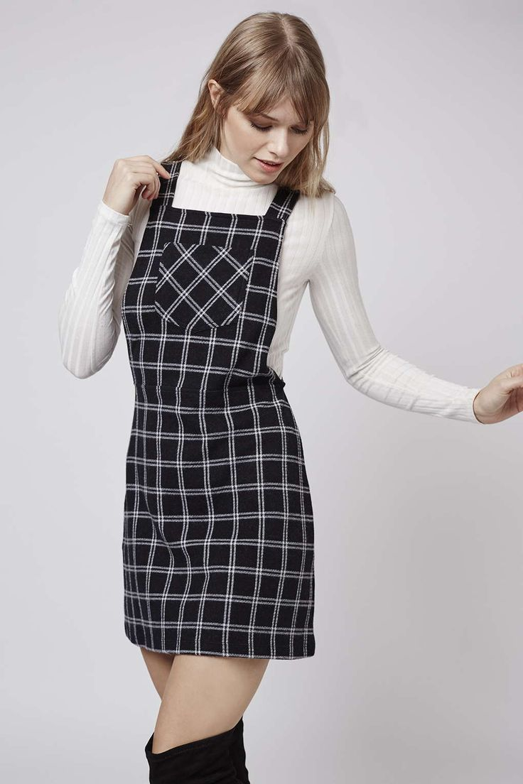 We've got your Back to School style sorted, this throw on and go pinafore checked dress is perfect with a ribbed funnel neck. #Topshop