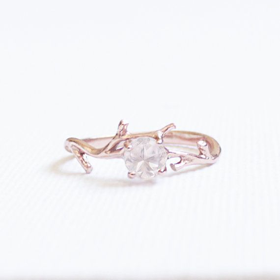 Sparkling faceted Rose Quartz semi precious stone ring that is prong set on a detailed branch Rose Gold Plated band. The stone is around 1 carat in