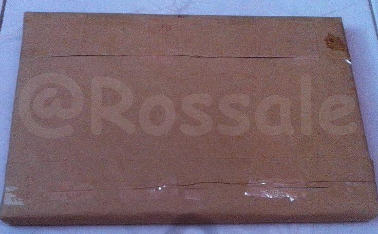 Setelah itu paket dilapisi dengan kertas cokelat sebagai lapisan kedua layaknya barang paketan lainnya