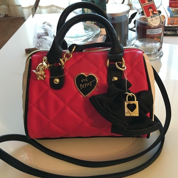 New Betsey Johnson Mini Barrel Purse Hot Pink +Bow Adorable mini barrel crossover purse by Betsey Johnson. Hot pink with black bow, heart charm and removable shoulder strap. Royal magenta interior lining. Enjoy! Betsey Johnson Bags Crossbody Bags