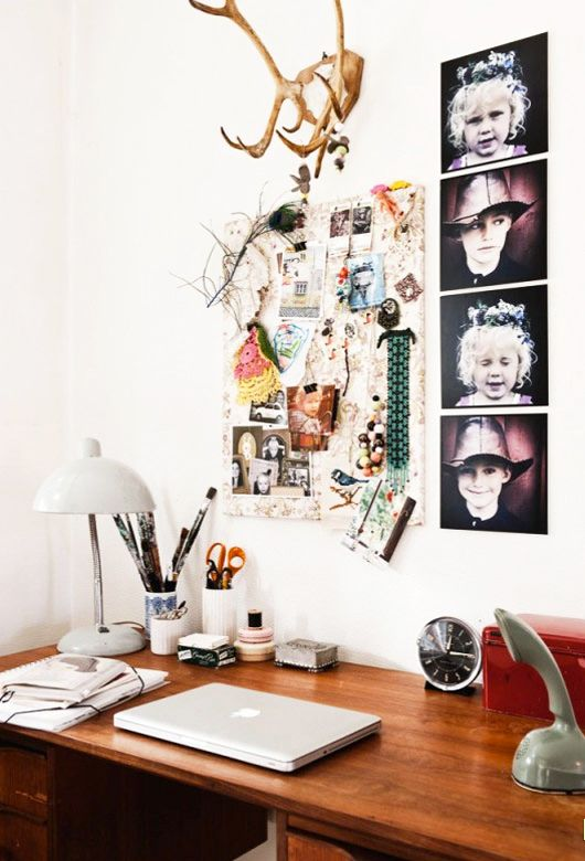 via SF Girl By the Bay--ideal workspace: enough pretty things to be interesting, but not cluttered
