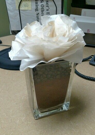 Coffee-themed centerpiece; stained coffee filters, beans, and grounds