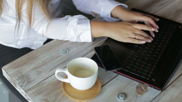 Female Hands Businesswoman Using a Laptop