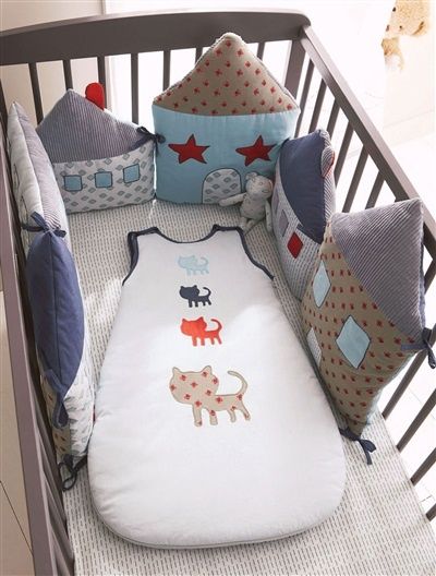 inspiration. cushions attached togeter for a cot bumper. When baby grows bigger they become individual cushions