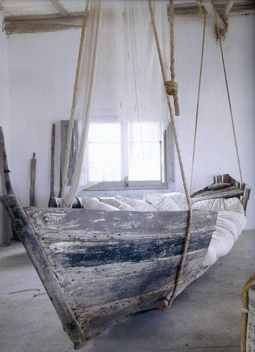 suspended boat bed; would be a fantastic  swinging bench. Love the tones and textures too: white, wood, concrete, rope.