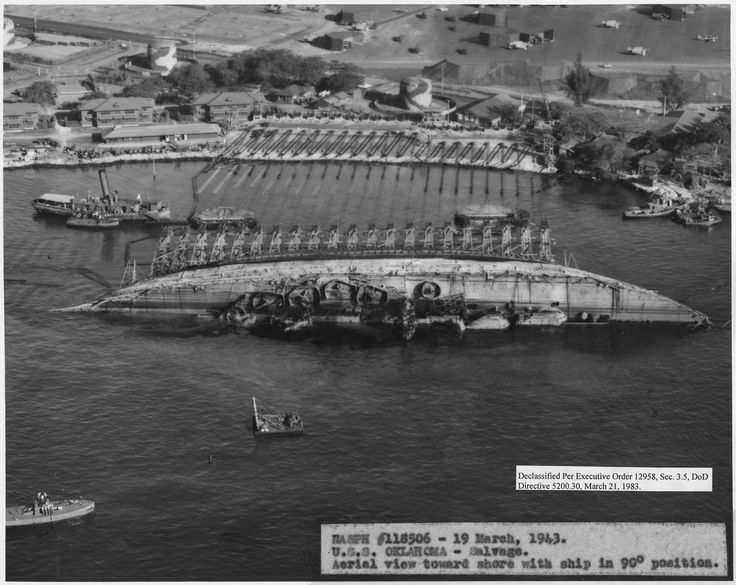 Righting the overturned hull of USS Oklahoma at Pearl Harbor, 19 March 1943