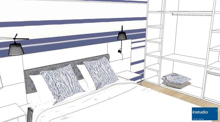 Uno schema colori tra il bianco e il blu rende fresche e luminose le stanze che abbiamo realizzato per un hotel al mare. Tra gli arredi un armadio a giorno e pannelli decorativi coordinati al rivestimento murale posizionato dietro al letto.