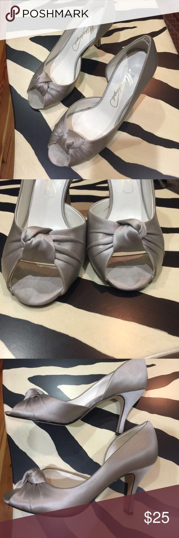 Silver peep toe heels Silver satin peep toe heels. Wore once in a wedding. Shoes Heels