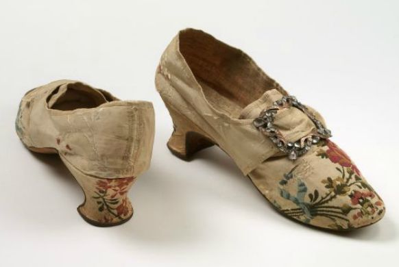 This pair of white brocaded silk wedding shoes has known provenance and an extant maker's label, which is extremely rare. The shoe buckles reflect the taste for colour and Rococo design in the late 18th century. London, England, 1770s Worn by Mary Gardner