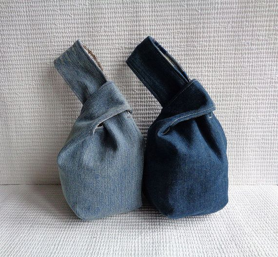 Handmade pouch - Japanese knot bag - Absolutely unique item. Great and unusual gift for a modern and stylish girl. 100% recycled fabric. Ties by feeding one handle into another. Very comfortable as a wristlet / mini bag to go for a walk or shopping. Denim outer, cotton lining. Size. Widest when open 7 3/4. Depth appx 6. Machine washable. This item is made to order! The pictures are samples of my previous work. It can be made dark, medium, light denim, stonewashed, dirty or untreated…
