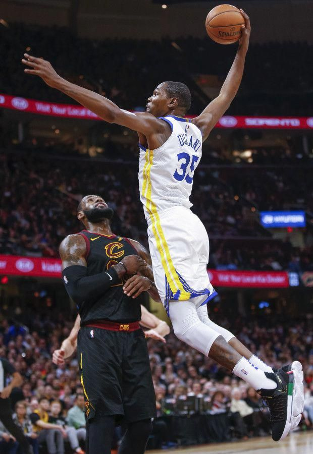 a4cdd7155978 Kevin Durant  35 of the Golden State Warriors goes up for the dunk over  LeBron James  23 of the Cleveland Cavaliers at Quicken Loans Aren…