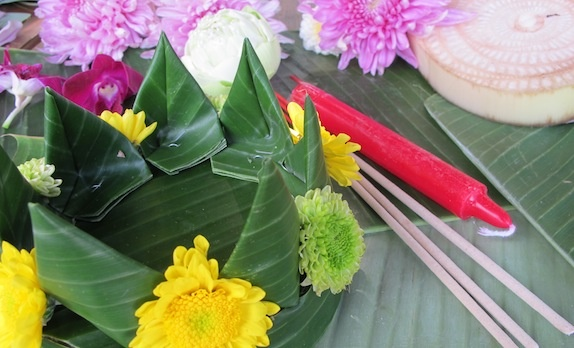 6. Place flowers, three incense sticks and a small candle in the center.