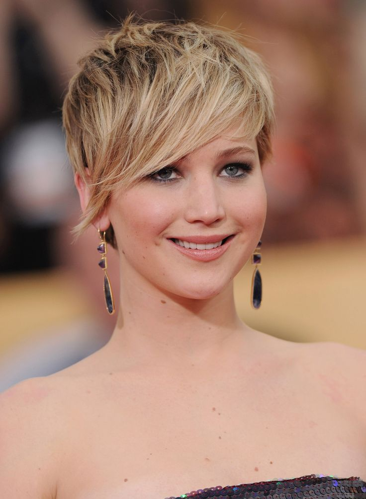 To offset the roundness ask your stylist for a pixie with an angled side-swept bang. For round faces the goal is to make it more elongated by providing height at the crown