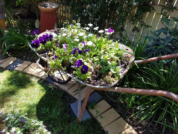 Upcycle old rusty wheelbarrow