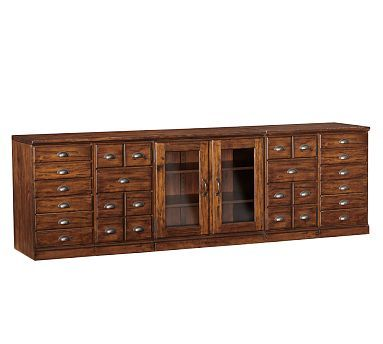 Pottery Barn printers media console...like the fact that we could get some of the file cabinets as well as drawers and that the glass allows easy access to tv boxes, etc.