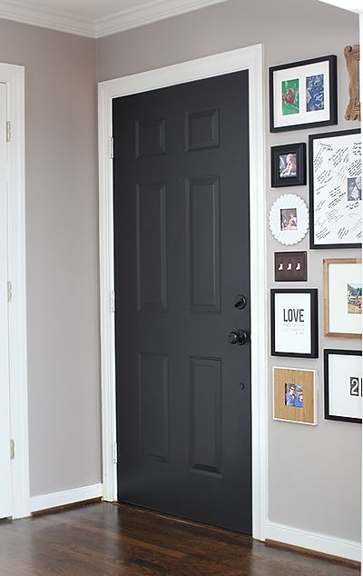 Door Color: Black Suede by Behr / --Satin finish with primer built in. They didn't sand before painting because it was latex on latex. If you're covering an oil-based paint with a latex-based paint (or vise versa), you'll want to sand before painting.   7thhouseontheleft.com-----lovely front entry.  Wall color:  It's Cobblestone by Martha Stewart (Home Depot). It's a tad darker in person than it appears in photos, but it's a great medium gray hue.