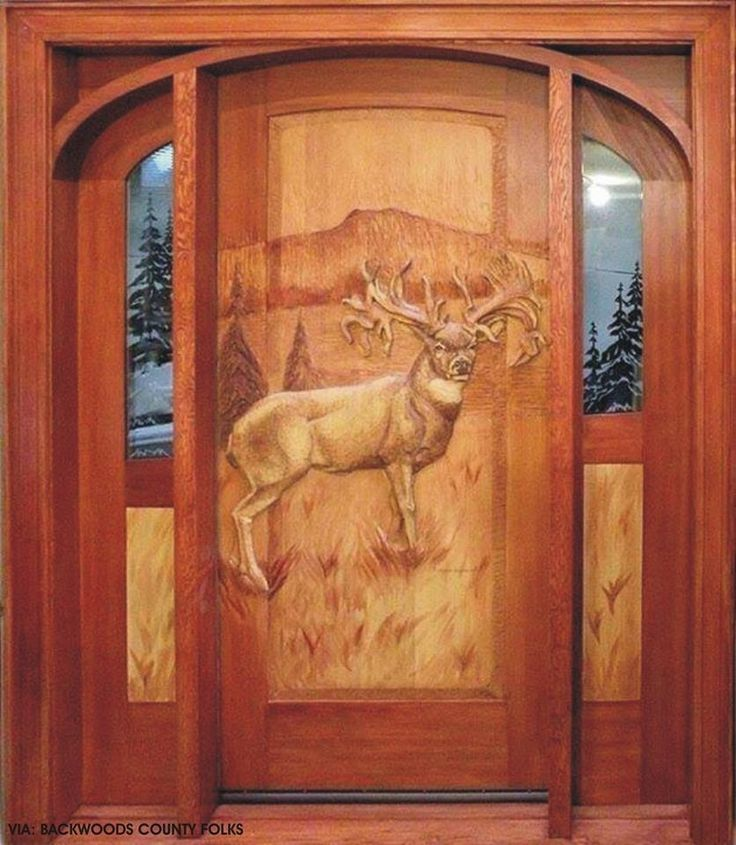 Carved Wood Door...again, gorgeous work, but to much for a home's front door.  Might be able to get away with it if it's on a western mountain lodge.