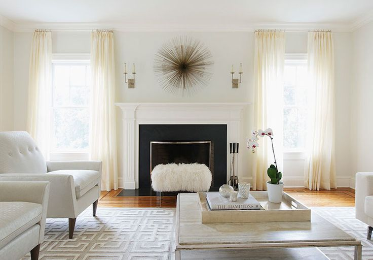 Laura Tutun Interiors - living rooms - cream curtains, cream drapes, windows flanking window, art over fireplace, fireplace art, fireplace s...
