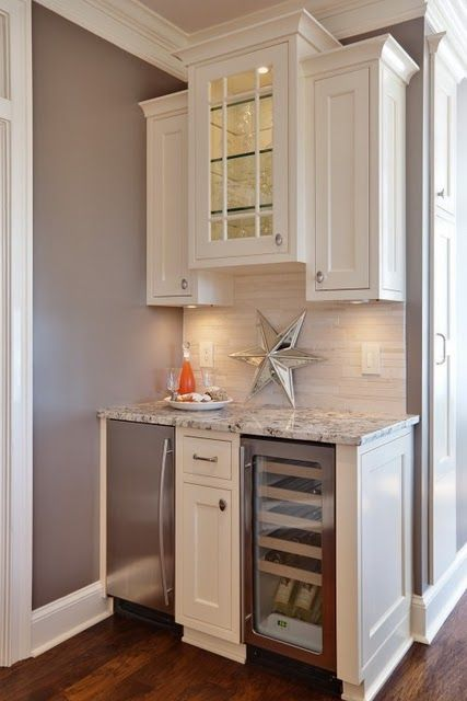 Beverage Bar Idea-perfect size- wine fridge and a ice maker. Add a sink.