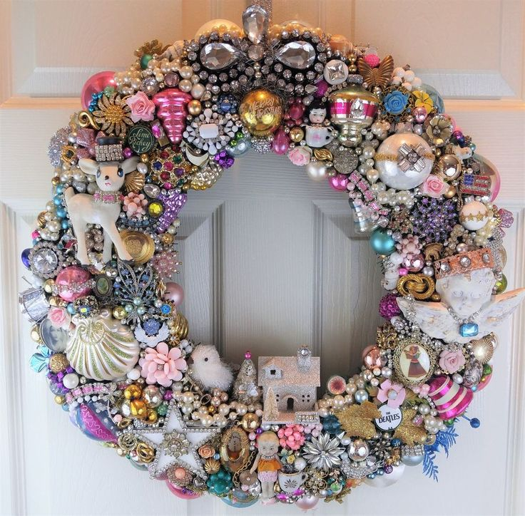 "So much stuff on this wreath.Oh Where to Begin?. Lots of jewelry, rhinestones and ornaments. Gorgeousand Loaded! It measures 4"" across, just to give you an idea. There is even an old angel ornament with a rusty crown! 