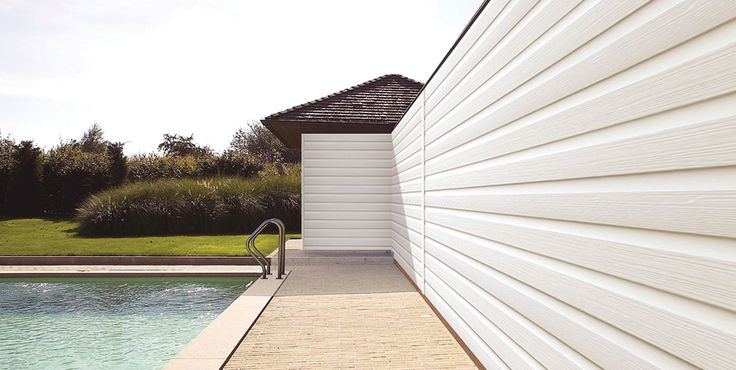 White Fortex external cladding (PVC) used for a beach effect around a pool house.