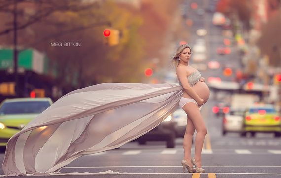 Uhhhh... really? on a busy street in a pair of whitey tighties with your big belly hanging out? this takes the cake for ridiculous maternity pictures.