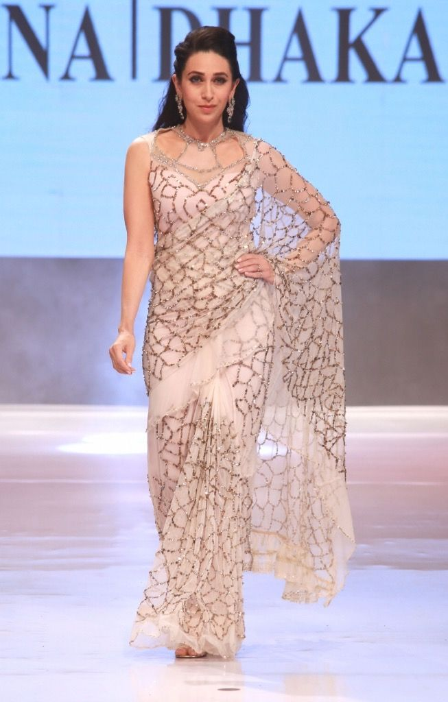 Karisma Kapoor showcases fashion designer Rina Dhaka's creations during Ambience Fashion Weekend 2016 in New Delhi, on Nov 6, 2016.