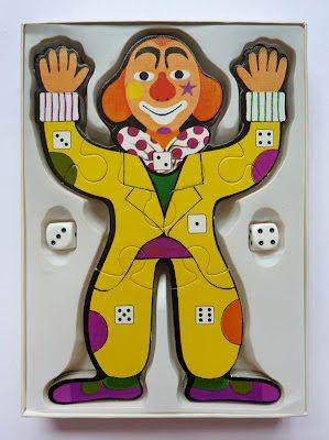 Clown spel. Met de dobbelstenen moet je het aantal ogen gooien wat op de lichaamsdelen staat .Wie het eerst de clown klaar had was de winnaar.