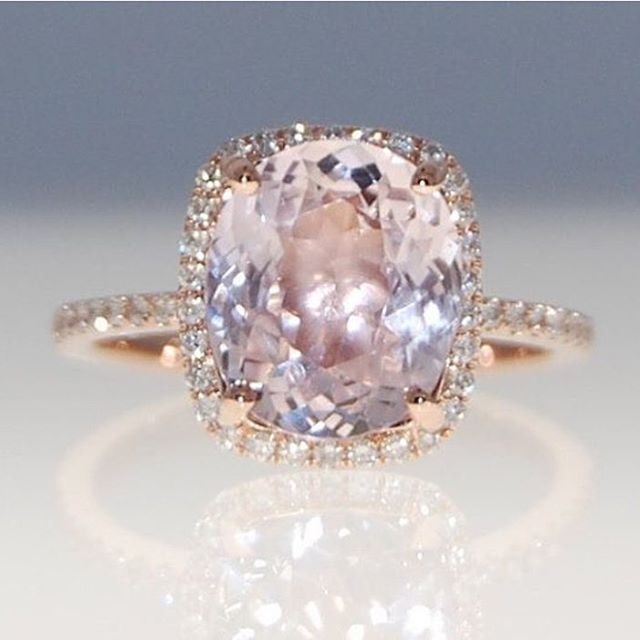 Rose gold engagement ring with a peach sapphire stone. Love love love!