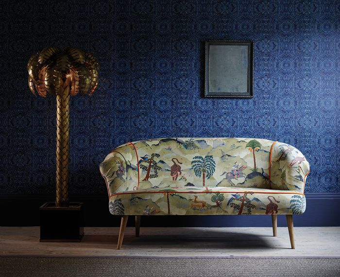 Lead design Aesop on the sofa - LF1922C/1. Labyrinth wallcovering in Indigo - LW65/4. The Fable Range by Linwood Fabrics. http://www.linwoodfabric.com/product-category/fabrics/fable/