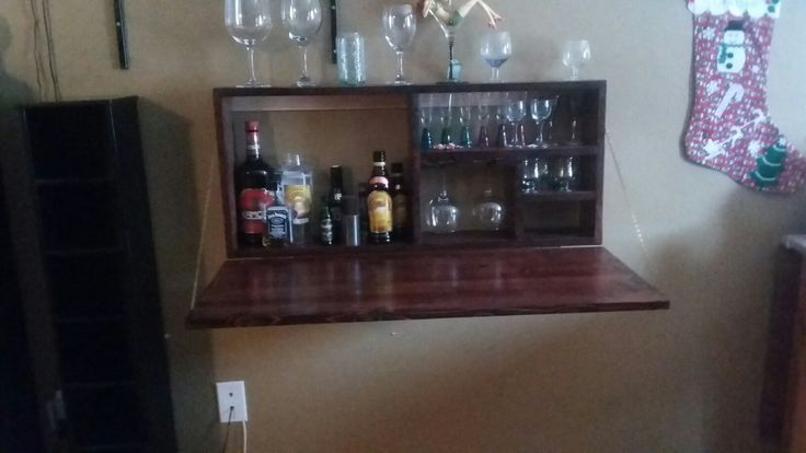 folding wall bar great for small places made from pine and stained red mahogany.$300.00 or best offer