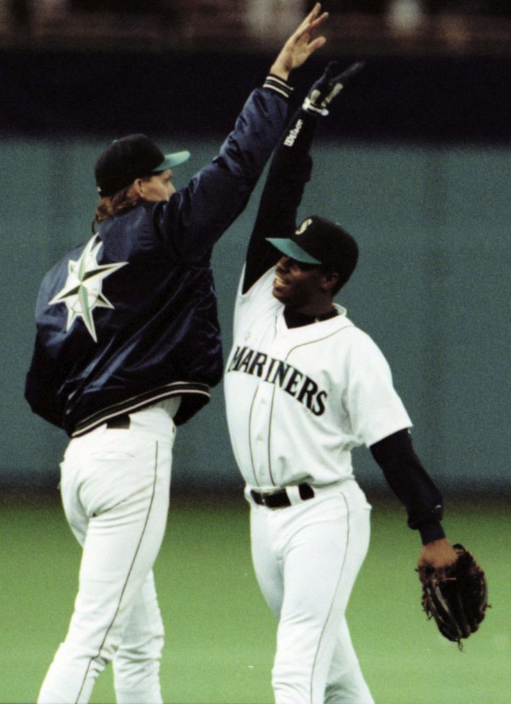 Randy Johnson left, and Ken Griffey Jr. exchange a truly high-five after keying the Seattle Mariners 6-3 victory over Toronto in 1993. (Alan Berner / The Seattle Times)
