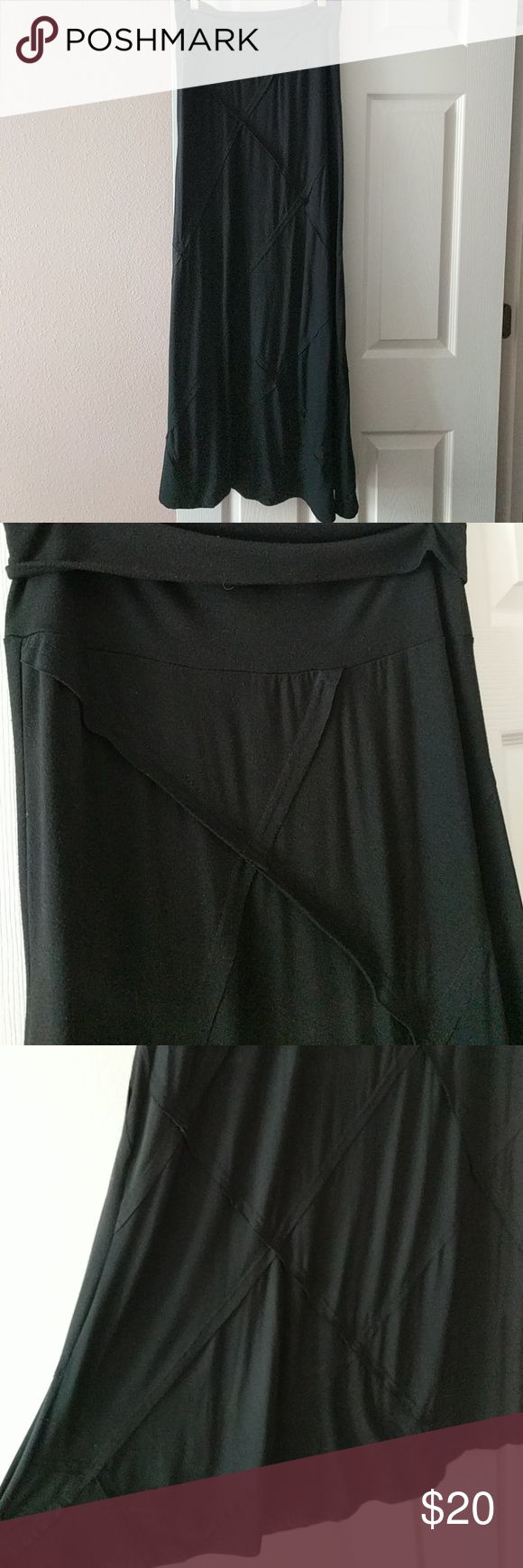 Black maxi skirt Cotton and spandex black maxi skirt with crisscross detail. Incredibly comfortable and great condition. Anthropologie Skirts Maxi