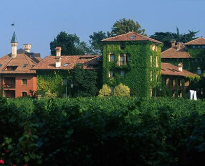 "Franciacorta, Italy: Some say the name of this magnificent wine region comes from ""francae curtes,"" a small medieval community of Benedictine monks that got tax exemption in exchange for teaching locals how to grow grapes! Today, Franciacorta is renowned for its production of sparkling wines. Where to Sleep: L'Albereta, perched on a hilltop in the Italian Alps amid orderly rows of grape vines, and with a view of Lake Iseo, the place radiates a sense of calm, culture, and refinement."