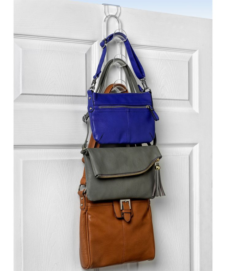 This Over the Door Purse Hanger gives you a simple way to store and organize purses right on a household door.