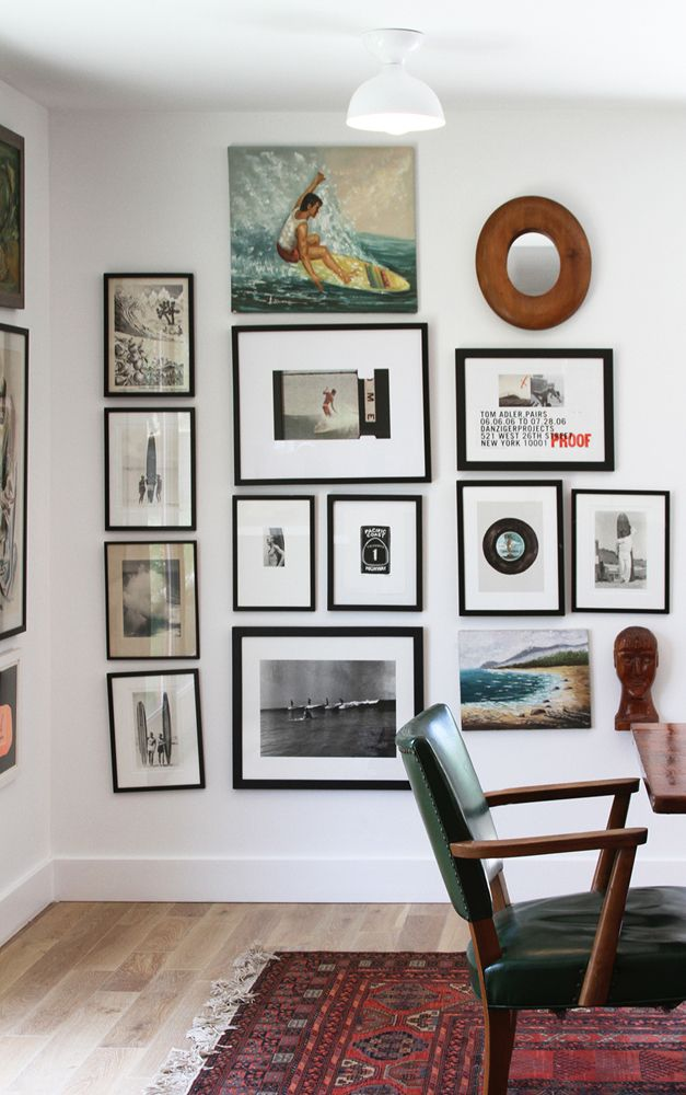 gallery wall. like the mix of photos and paintings