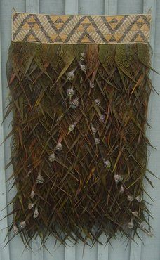 This maori cloak has lots of different taniko patterning an example of this is the aramoana,sea stripes.