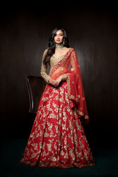 Bridal Lehengas - Crimson Red Lehenga | WedMeGood | Crimson Red Lehenga with Golden Overall Sequinned Embroidery with a Golden Sheer Blouse Outfit by: Shyamal and Bhumika #wedmegood #indianbride #indianwedding #crimson