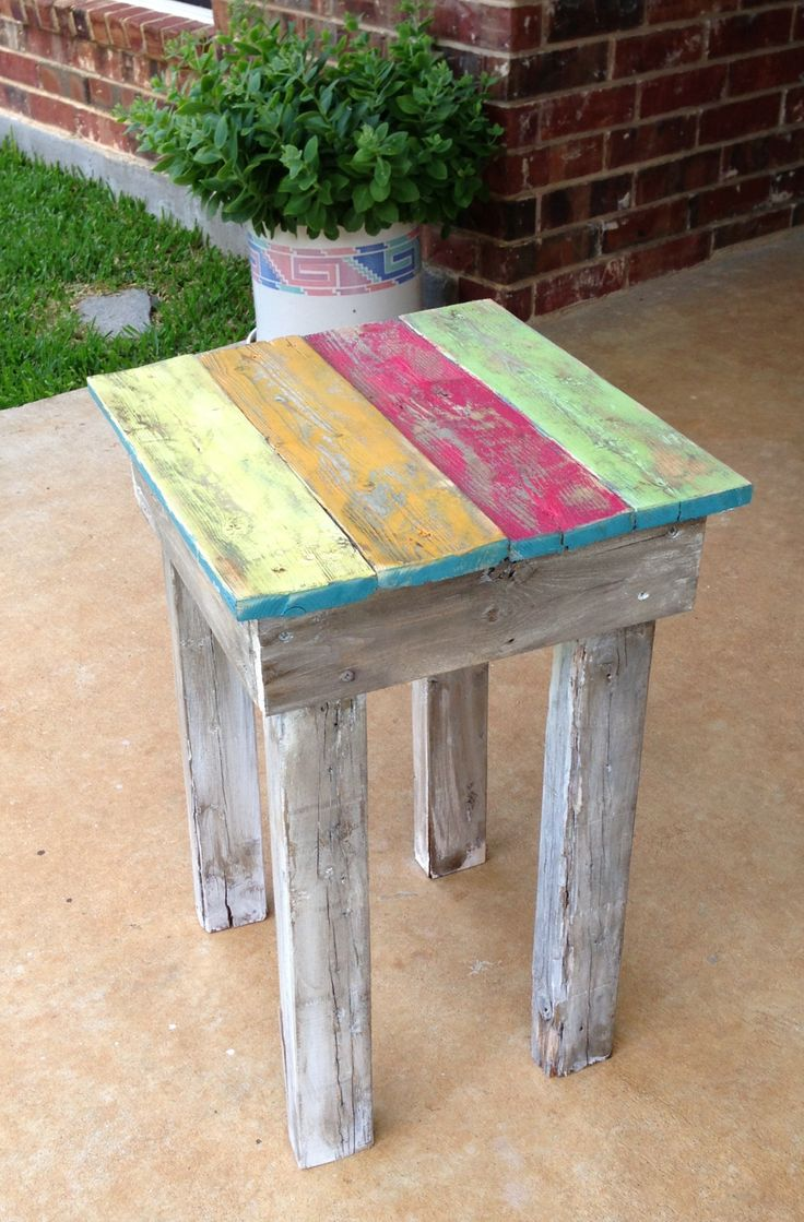 Recycled fence pickets made into a small coffee table painted.