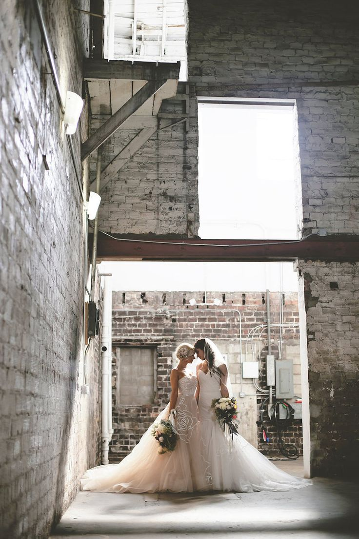 Same Sex Gay Brides in Blush and Ivory Strapless Wedding Gowns Wedding Portrait | Tampa Wedding Venue Rialto Theater | Wedding Photographer FotoBohemia