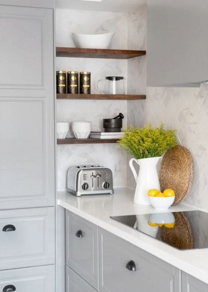 Attractive way to avoid deep corner cabinets. Not all storage needs to have a door -- showcase some of your pieces on easy-to-install corner shelves instead. Samantha Pynn Kitchen.