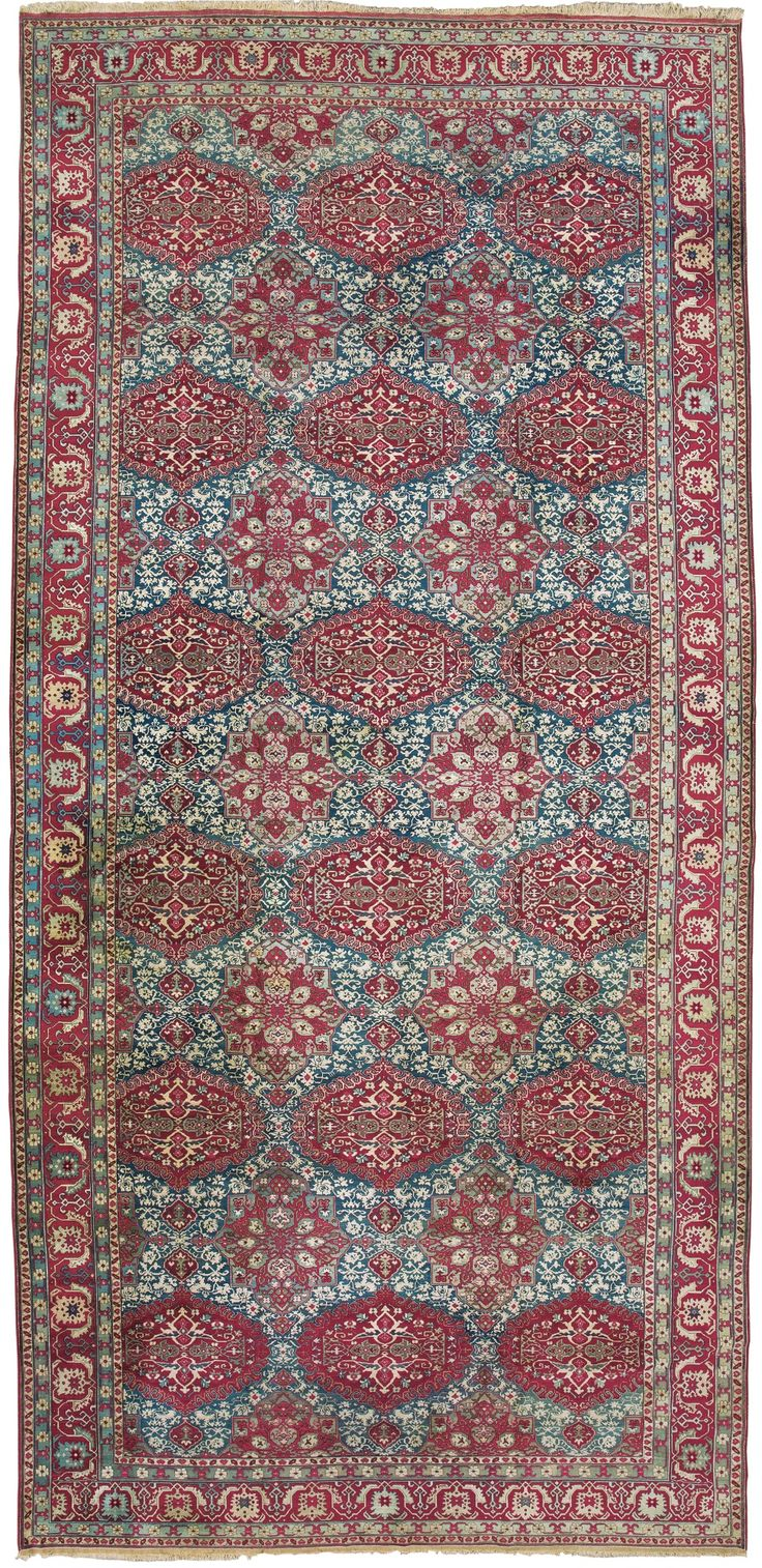 Indian Agra rug, unusually, with a design based on a 16th century Ottoman Oushak 'medallion' carpet, 746 by 333cm, circa 1900, Sotheby's