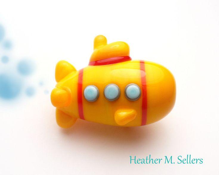 Yellow Submarine, a lampwork glass bead by Heather Sellers. #yellowsubmarine…