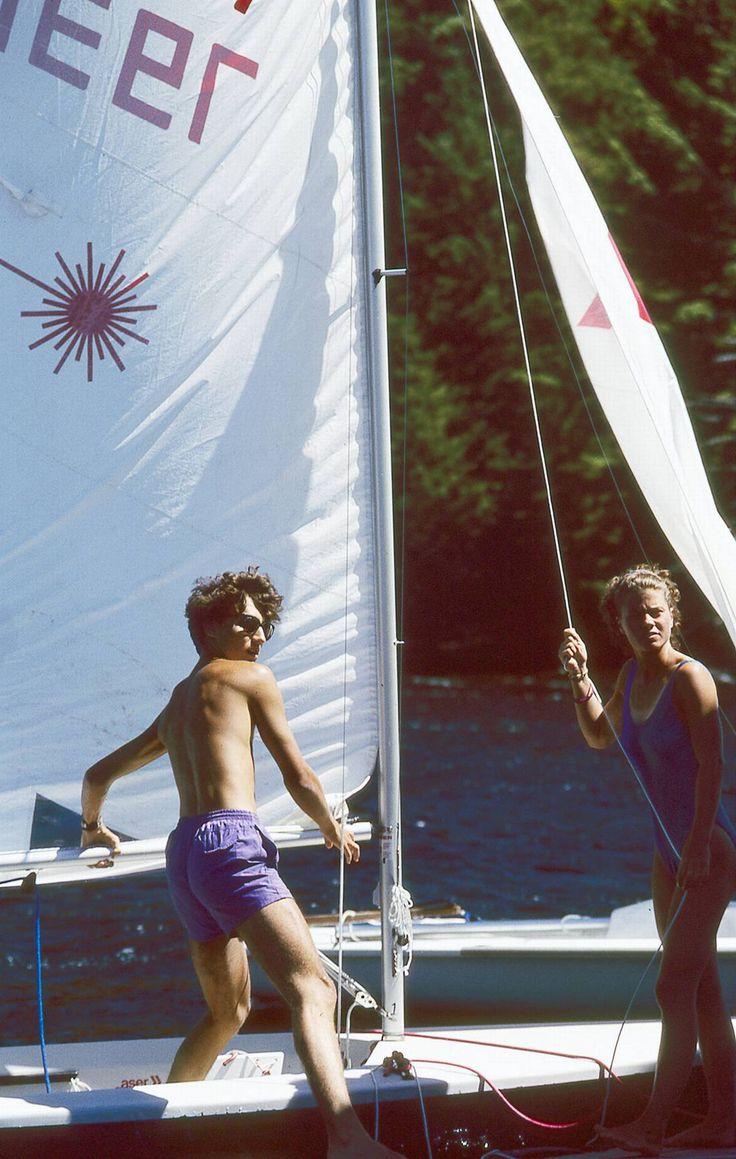 Justin Trudeau, 18, prepares a sailboat with fellow counsellor Marie Clement at Algonquin Park's Camp Ahmek in 1992.