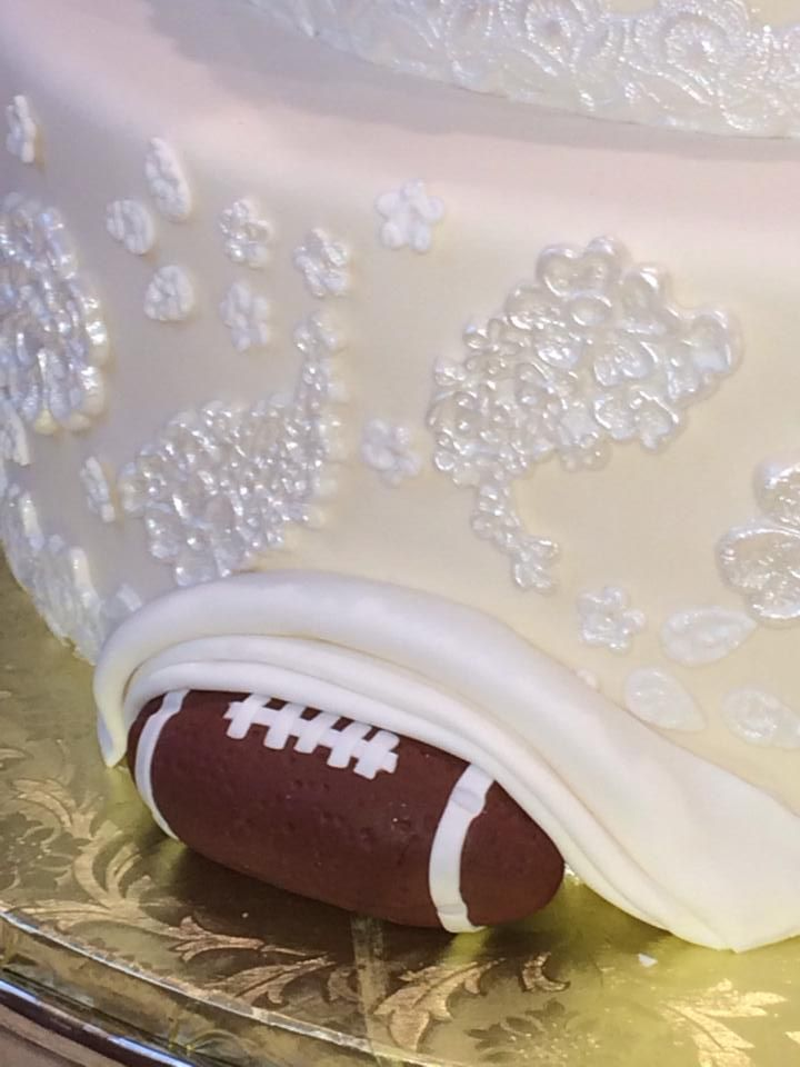 The football in the back of the 5 tier lace wedding cake... would be cute to do with hunting some how