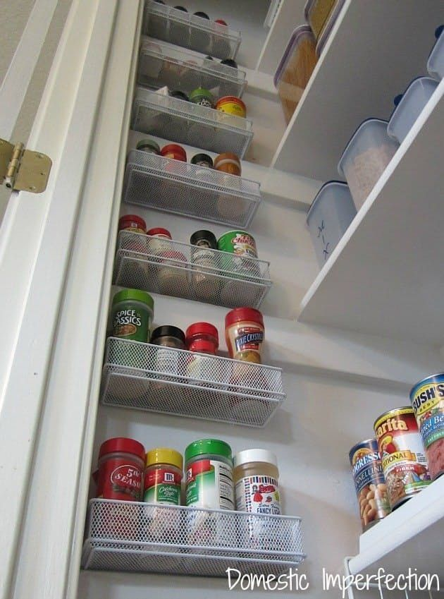 Mount cheap office supply organizers in that wasted space inside the pantry door. Great for storing spices and small items and packets! | Domestic Imperfection
