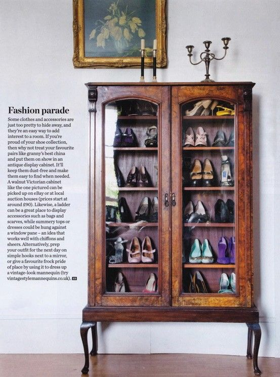 Shoe storage idea in an antique china cabinet.